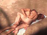 Sex on a public nudist beach filmed by voyeur