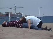 Kinky wife sucking hubby and swallowing cum at the beach
