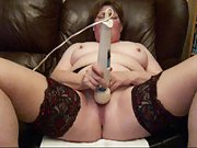 Redhead milf using vibrator on her couch at home