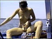 My wife displaying her pussy and clitoris while boating